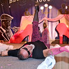 (Brad Davis/The Register-Herald) Participant David Jones poses gloriously for spectators on the stage during the annual Hunks in Heels fundraising event for the Women's Resource Center Friday night at the Beckley Moose Lodge.