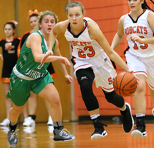 (Brad Davis/The Register-Herald) Summers County's Brittney Justice speeds up the court past Charleston Catholic's Maddie Blaydes during the Lady Bobcats' win over the Irish Saturday night in Hinton.