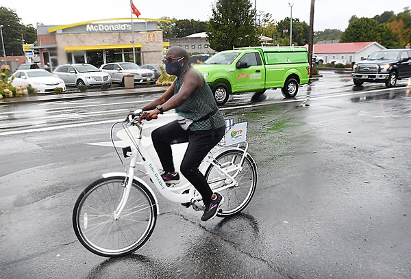 Annette Bradshaw, of Beckley, tries out the new Beckley Bike Share Program at the Beckley Welcome Center on Prince Street.<br /> (Rick Barbero/The Register-Herald)