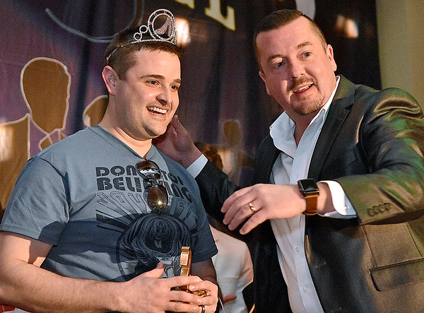 """(Brad Davis/The Register-Herald) This year's newly crowned """"Mr. Hunks in Heels"""" Brandon Thompson is crowned by 2016's Mr. Hunks Scott Parker at the conclusion of the annual event Friday night at the Beckley Moose Lodge."""