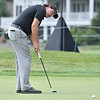 (Brad Davis/The Register-Herald) Phil Mickelson putts on 10 during Wednesday's Pro-Am in White Sulphur Springs.