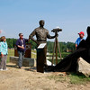 Mike and Gillian Goodrich, left, look as the BSA unveil a bronze statue of Mike, who Goodrich Lake is named after, during a ceremony Thursday as part of the 2017 National Jamboree at The Summit Bechtel Reserve. Goodrich is a recipient of the Silver Buffalo Award, the BSA highest honor for service to youth. (Chris Jackson/The Register-Herald)