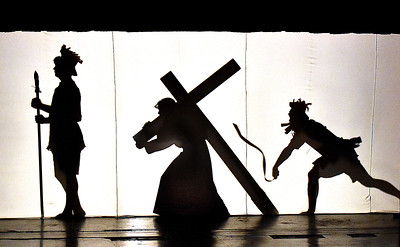 (Brad Davis/The Register-Herald) Jesus carries his cross as young actors from the Catholic Youth Group of Saints Peter and Paul Catholic Church perform scenes from The Living Stations of the Cross in Silhouette in observance of Palm Sunday inside the Oak Hill High School Auditorium.