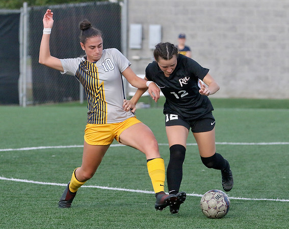 (Brad Davis/For The Register-Herald) WVU Tech's Ana Gay Mesa battles for possession with Rio Grande's McKenna Sullivan Saturday afternoon at the YMCA Paul Cline Memorial Sports Complex.