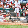 (Brad Davis/The Register-Herald) James Monroe catcher Eli Ballard shows the home plate umpire he still has the ball after tagging out Bridgeport's Nathan Paulsen with game tied 3-3 in the bottom of the 7th inning, holding off an Indians rally Friday afternoon at Appalachian Power Park in Charleston. Unfortunately Bridgeport would walk off the Mavericks with an RBI-single a batter later, ending their season with a 4-3 loss.
