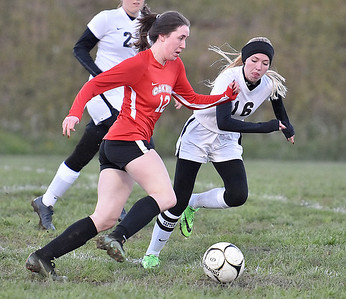 (Brad Davis/The Register-Herald) Oak Hill's Courtney Smith speeds past PikeView's Leah Flanigan on her way to scoring the game's opening goal Wednesday evening in Oak Hill.