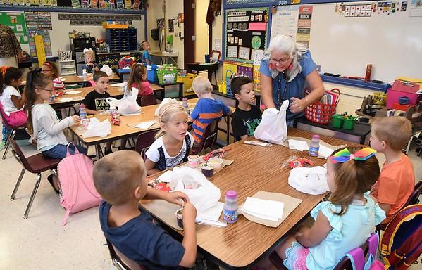 Karen Greer, kindergarten teacher Crescent Elementary School in Beckley, work with her new students during the first day of school in Raleigh County. (Rick Barbero/The Register-Herald)