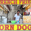 Keith Atkinson get the Doghouse stand set up at the State Fair of West Virginia Monday. Jenny Harnish/The Register-Herald