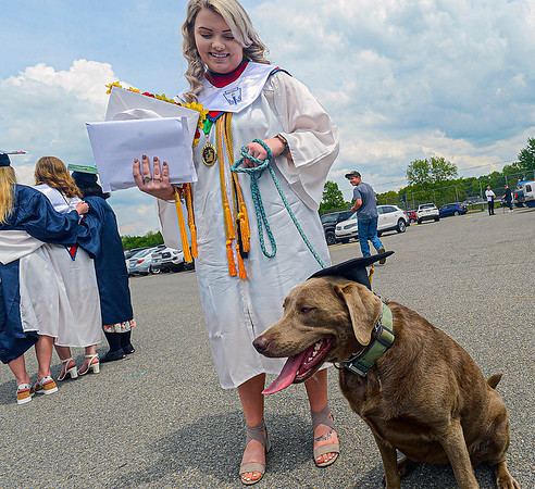 """F. Brian Ferguson/Register-Herald Independence graduate Leah Vickers and her trusted pal """"Willow"""" show off their caps and gowns after Saturday's graduation in Independence."""