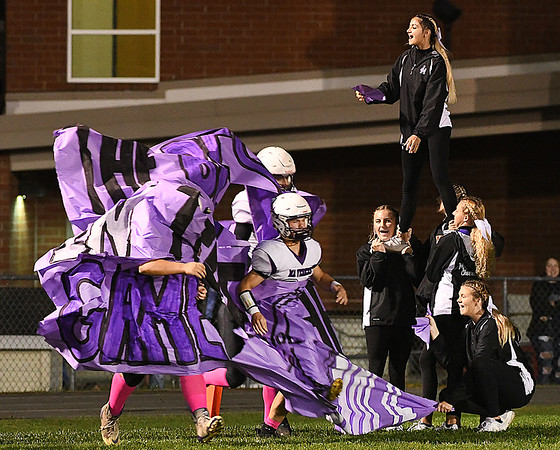 James Monroe team bust through a banner held by the cheerlearders before game against Greenbrier West.