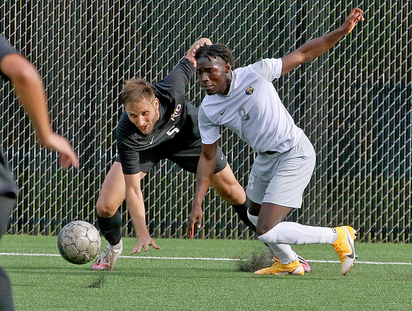 (Brad Davis/For The Register-Herald) WVU Tech's Endjick Albert battles for possession with Rio Grande's Silas Machado Saturday afternoon at the YMCA Paul Cline Memorial Sports Complex.