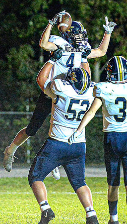 F. Brian Ferguson/Register-Herald Nicholas County's Alex Pritt is held high by Bryson Phipps after Pritt scored a TD against Midland Trail during Friday action in Hico.