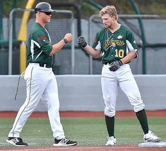 (Brad Davis/The Register-Herald) Miners player Maddux Houghton, right, gets a fist bump from 3rd base coach Korey Dunbar after smacking a 2-run triple that scored teammates Colby Johnson and Fernando Ortiz to cash in for a big 3rd inning against Chillicothe Friday night at Linda K. Epling Stadium.
