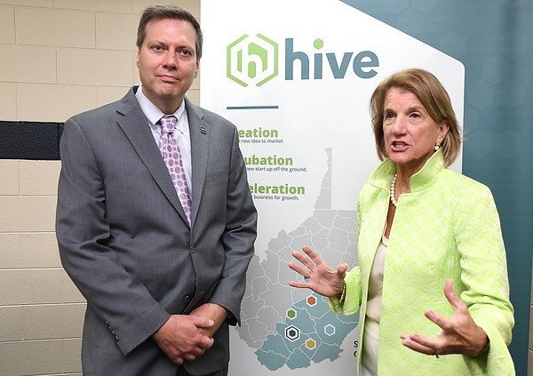Senator Shelly Moore Capito, right and ARC Co-Chair Tim Thomas, speak speak during a tour of the HIVE network, an entrepreneurial support network serving locations in Beckley, Summersville, Lewisburg, and Hinton. (Rick BArbero/The Register-Herald0