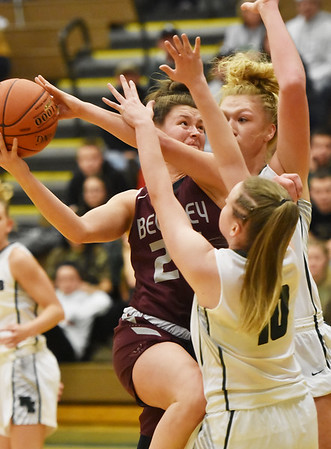 Woodrow Wilson's Elizabeth Cadle (12) tries to drive to the basket as Wyoming East's Leslie Saunders and (10) during their basketball game Wednesday in New Richmond. (Chris Jackson/The Register-Herald)