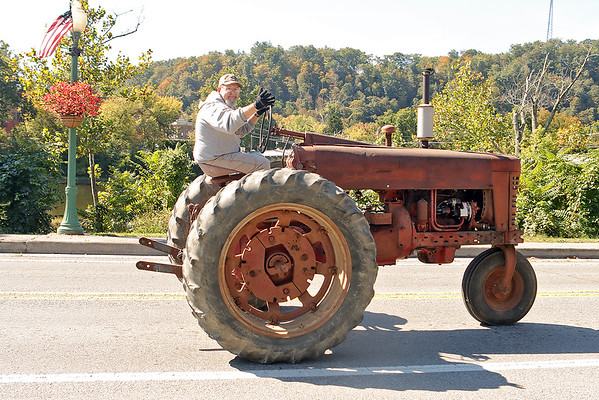 A member of the Tahoe Tractor Club drives through Alderson during the Antique Tractor Ride Saturday. Jenny Harnish/The Register-Herald