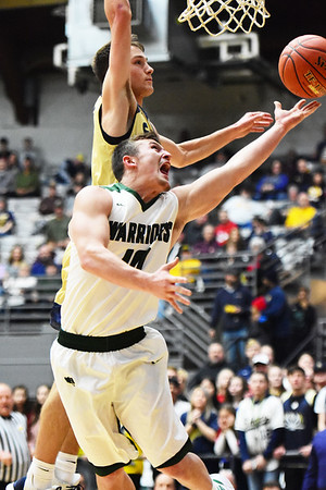 Wyoming East's Chase York (10) puts up a shot as Shady Spring's Tommy Williams (0) tries to block during their basketball game in Beckley on Thursday. (Chris Jackson/The Register-Herald)