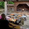 (Brad Davis/The Register-Herald) Patrons watch from the upper dining room area and below on the outer deck as Lewisburg musician Jim Snyder (on stage) performs among a handful of other local musicians during a day of tunes and hanging out at the Chimney Corner Cafe & Amphitheater Sunday afternoon near Ansted.