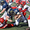 (Brad Davis/The Register-Herald) Nicholas County's Jacob O'Dell is taken down by the Weir defensive trio of (from left) Christopher Helms, Brodie McUmar (#9) and Sebastian Spencer Saturday afternoon in Summersville.