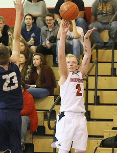 (Brad Davis/The Register-Herald) Independence's Blake Stone shoots from three-point range before Greenbrier West defender Chase Hagy can get to him Friday night in Coal City.