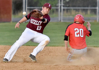 (Brad Davis/The Register-Herald) St. Albans' Travis Atkins slides safely into 2nd as the throw is late getting to Woodrow Wilson shortstop Michael Maiolo during the Flying Eagles' loss to St. Albans Friday evening in Beckley.