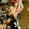 (Brad Davis/The Register-Herald) Wyoming East's Emily Saunders drives and score as Westide's Hannah Toler defends Thursday night in New Richmond.