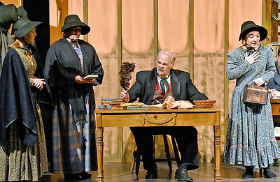 (Brad Davis/The Register-Herald) Scrooge, played by Gene Worthington, appalls a group of charity workers with his insults and refusal to donate to the poor during a rehearsed scene Treehouse Arts Ensemble's production of A Christmas Carol, which opens tonight at Tamarack.