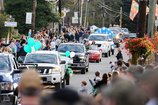 Hundreds gather to watch the last Fayetteville High School Homecoming Parade in Fayetteville on Friday. (Chris Jackson/The Register-Herald)