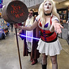 "(Brad Davis/The Register-Herald) Comic book antihero Harley Quinn, a.k.a. Teagan Kelley of Sissonville, blows a kiss to the camera as she and ""Tony Wan Kenobi,"" a.k.a. Adam Hill of Charleston, patrol the floor during Causeacon Saturday afternoon at the Beckley-Raleigh County Convention Center."