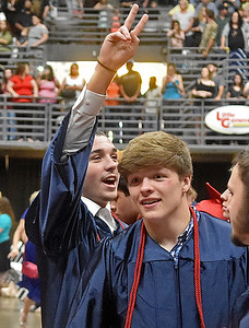 (Brad Davis/The Register-Herald) A pround Independence graduate gestures towards friends and family in the stands Saturday morning at the Beckley-Raleigh County Convention Center.