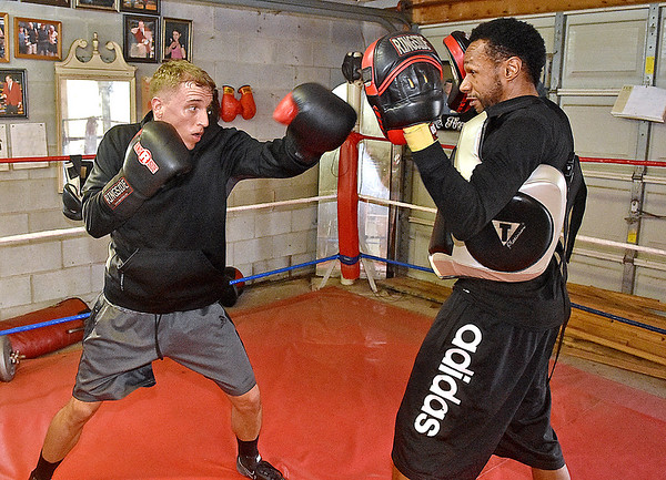 (Brad Davis/The Register-Herald) Toughman Contest fighter Bobby Belcher (left), the 2013 Beckley champion, trains with two-time Toughman champion Charles Moore Monday evening at the Mount Hope Boxing Club.