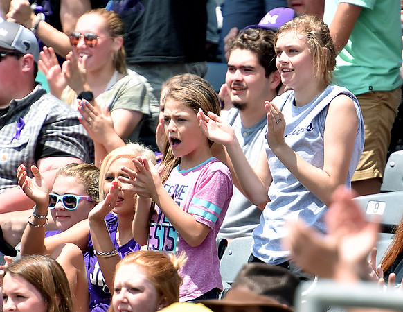 (Brad Davis/The Register-Herald) James Monroe fans and family during their game the Bridgeport Indians Indians Friday afternoon at Appalachian Power Park in Charleston.