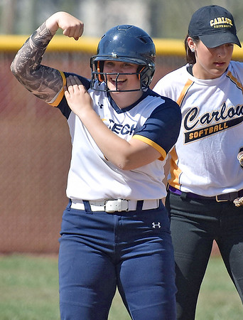 (Brad Davis/The Register-Herald) WVU Tech's Annika Ponton flexes some muscle towards her cheering teammates in the dugout after smashing a double into the left centerfield gap against Carlow University Saturday afternoon at Woodrow Wilson High School.