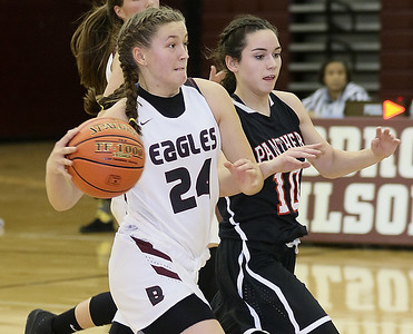 (Brad Davis/The Register-Herald) Woodrow Wilson's Liz Cadle shields the ball from PikeView's Hope Craft as she moves up the court Thursdsay night in Beckley.