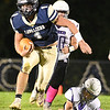 Ty Nickell, 1, of Greenbrier West, breaks away of James Monroe defenders during game Friday evening at Greenbrier West High School.<br /> (Rick Barbero/The Register-Herlad)
