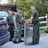 The Greenbrier County Sheriffs Department and West Virginia State Police officers carry tools to assist during a search for human skeletal remains on the Alderson side of Muddy Creek Mountain Tuesday. A landowner discovered the remains while clearing brush on his property. Jenny Harnish/The Register-Herald