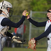 Kaylen Parks, Independence catcher, high fives as she gives the ball back to the pitcher, Delaney Buckland during a game against Liberty. Jon C. Hancock/for The Register-Herald