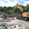 SMH Construction is building a temporary bridge on Route 3 near Glen Morgan to use before replacing the old bridge that stands above Piney Creek.<br /> (Rick Barbero/The Register-Herald)