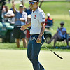 (Brad Davis/The Register-Herald) Fans cheer in the background as Kevin Na reacts to hitting another long putt for birdie on 8 during the Military Tribute at The Greenbrier Sunday afternoon in White Sulphur Springs.