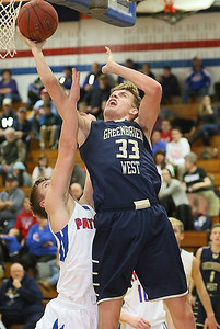 (Brad Davis/The Register-Herald) Greenbrier West's Riley O'Dell turns and scores from underneath the goal as Midland Trail's Beau Campbell defends Friday night in Hico.