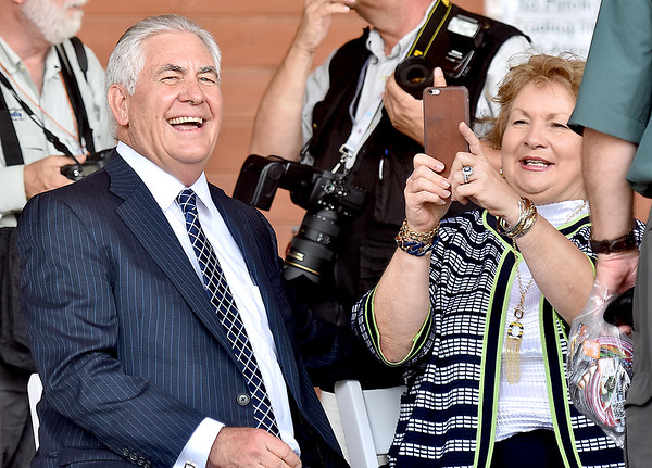 (Brad Davis/The Register-Herald) United States Secretary of State Rex Tillerson and his wife Renda St. Clair have a few laughs as they mingle during the opening moments of a ceremony for the unvieling of plans for a center named for him on the grounds of the Bechtel Summit Reserve Friday afternoon.