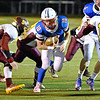 (Brad Davis/The Register-Herald) Midland Trail's Morgan Ferris carries the ball near the goalline as Sherman's Tommy Harper (#5) lowers to hit him Friday night in Fairlea.