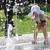 Ember Bolger, 1, plays in the Green Space Fountain in downtown Lewisburg Wednesday. Bolger moved with her family from Pennsylvania and her father is in his second year at the West Virginia School of Osteopathic Medicine. (Jenny Harnish/The Register-Herald)