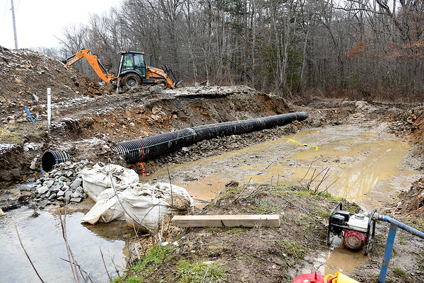 SMH Construction are prepping a drain ditch for new concrete drain blocks to be installed on New River Drive in Beckley.<br /> (Rick Barbero/The Register-Herald)