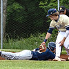 J.P.  Girod of Nicolas Co sliding back to first base when trying not to be picked off , Adam Richmond of Shady Spring with the tag, Thursday night during Sectionals at Shady Spring High School.