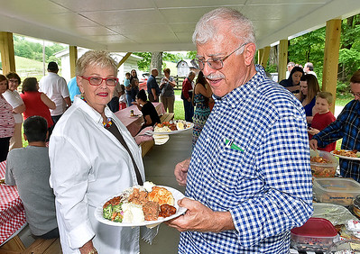 (Brad Davis/The Register-Herald) Roanoke, Virginia residents Barry and Julie Akers have been coming to Sacred Heart's annual Memorial Day picnic together for the last 47 years.