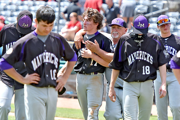 (Brad Davis/The Register-Herald) James Monroe players and coaches console each other following a 4-3 loss to the Bridgeport Indians Indians Friday afternoon at Appalachian Power Park in Charleston.