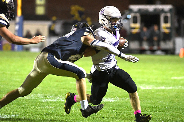 Grant Lively, of James Monroe, right, breaks away from a Greenbrier West defender during the first half Friday evening at Greenbrier West High School.<br /> (Rick Barbero/The Register-Herald)