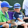 Parker Laubscher, left and his brother Preston Laubscher, of Richmond, Va., watching play on the 17th hole during the first round of, A Military Tribute at The Greenbrier.<br /> (Rick Barbero/The Register-Herald)