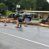 First responders and work crews work to clear the intersection of Maple Fork and U.S. 19 from a tractor trailer carrying logs turn over in Maple Fork on Tuesday. (Chris Jackson/The Register-Herald)